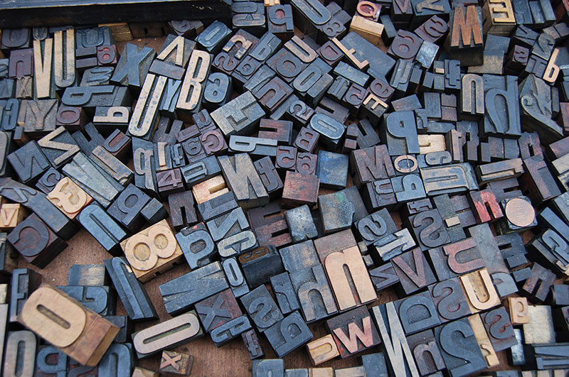 Letter blocks scrambled on the ground