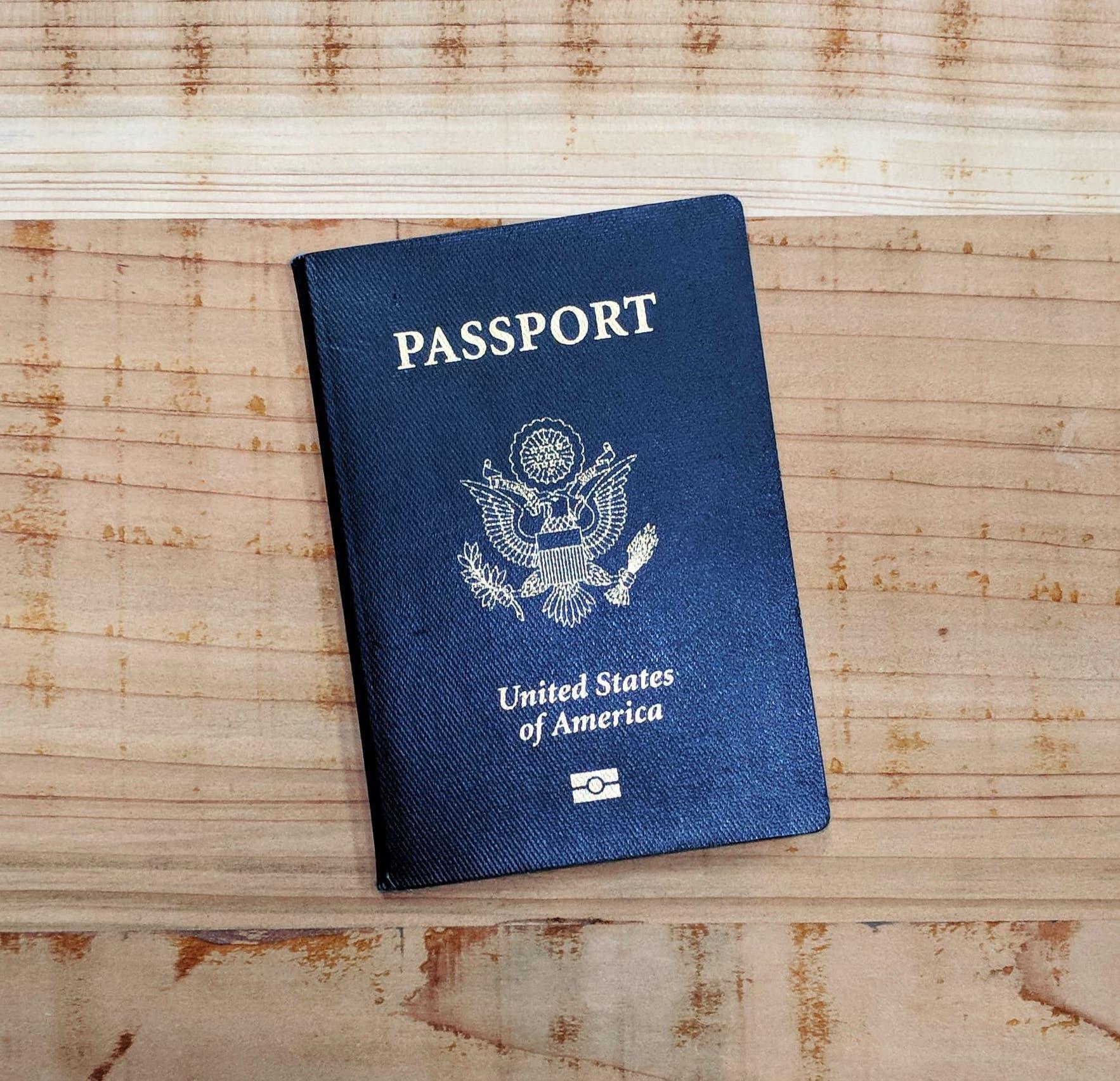 image of passport on wood