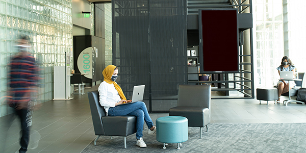 Students sitting in a lounge working