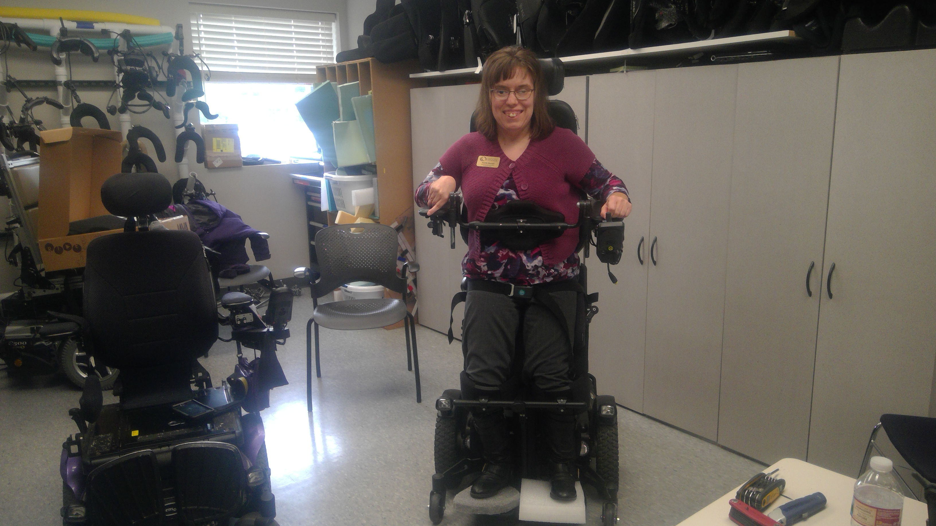 A woman trials a standing power chair