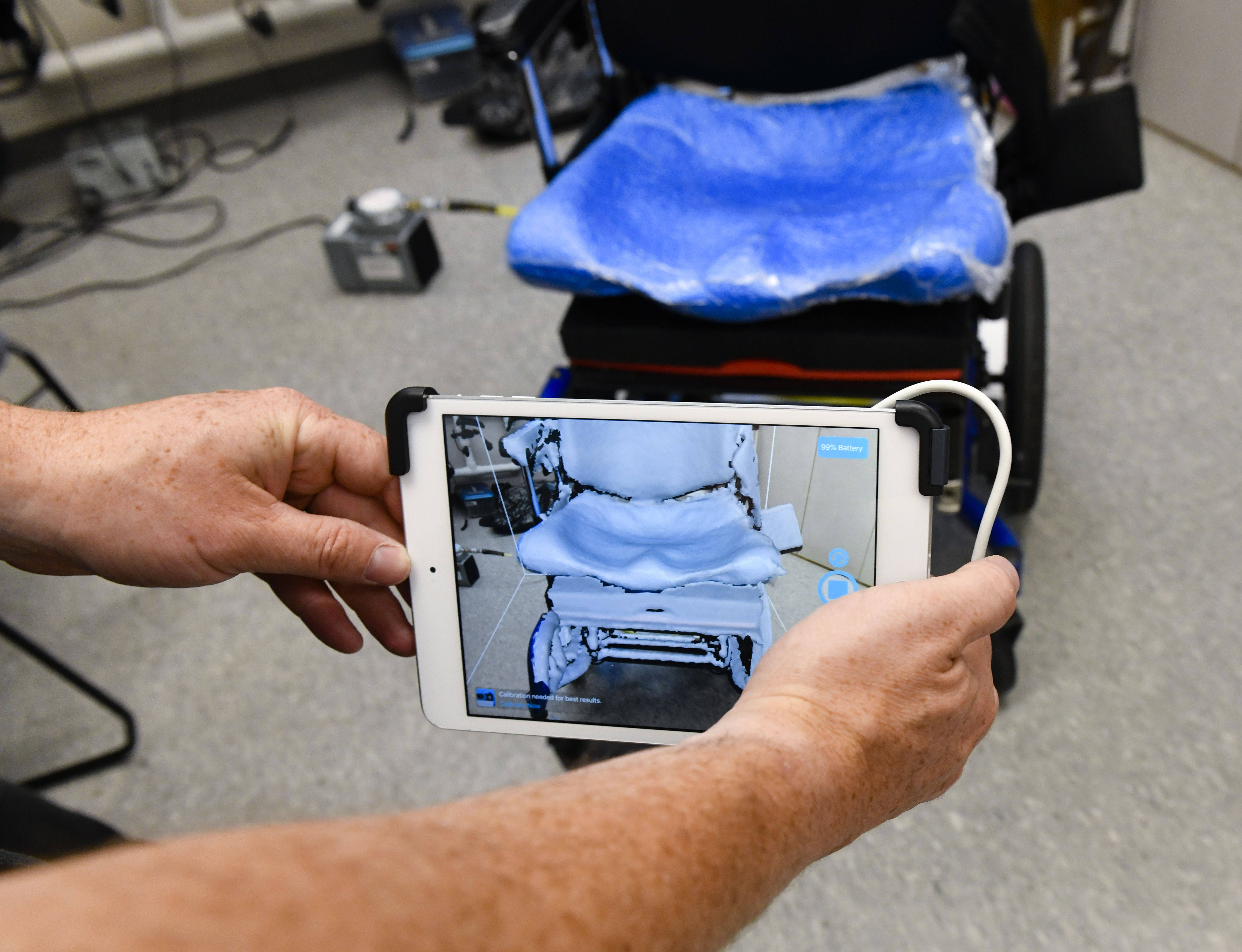 a custom wheelchair  seat mold is visualized using an ipad