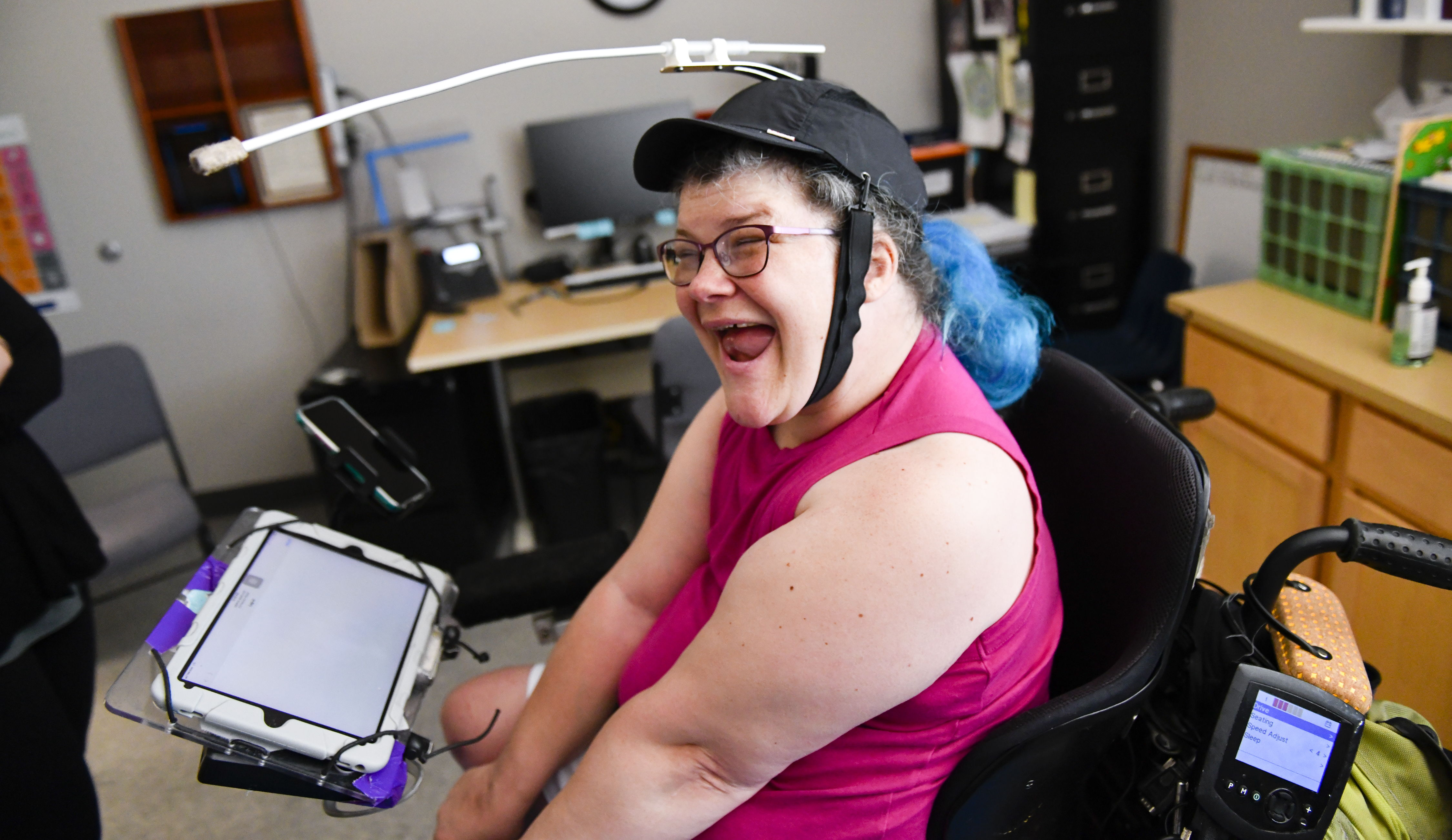 a woman smiles from her wheelchair