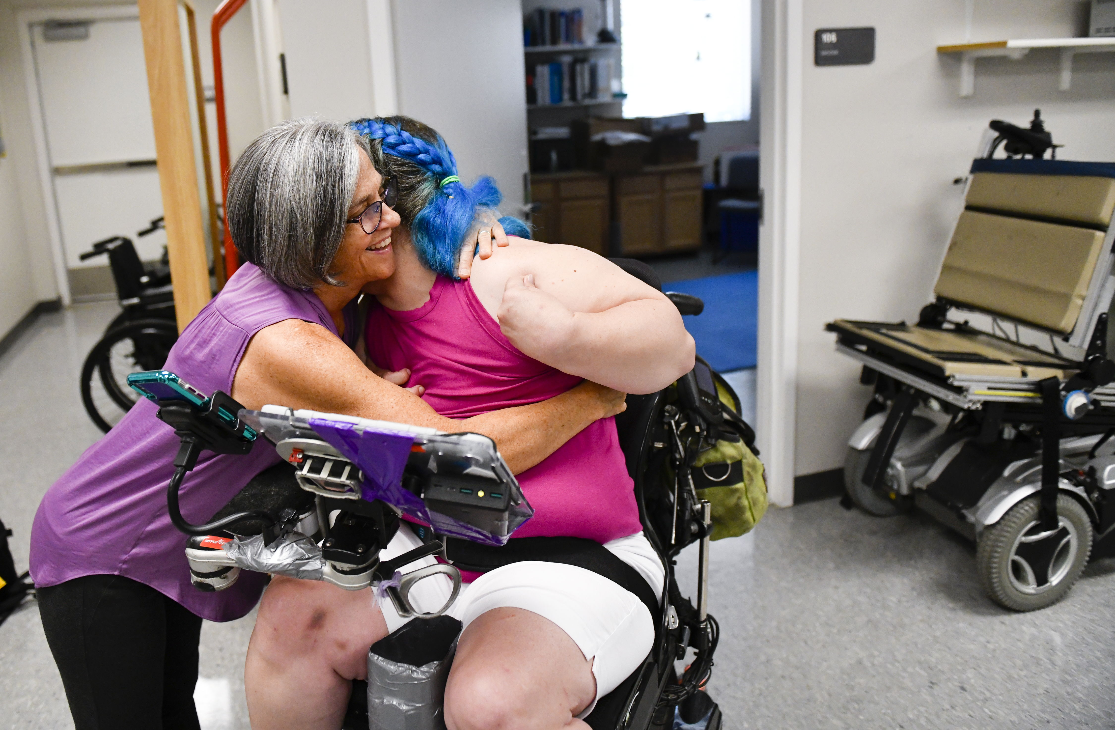 a client hugs her physical therapist