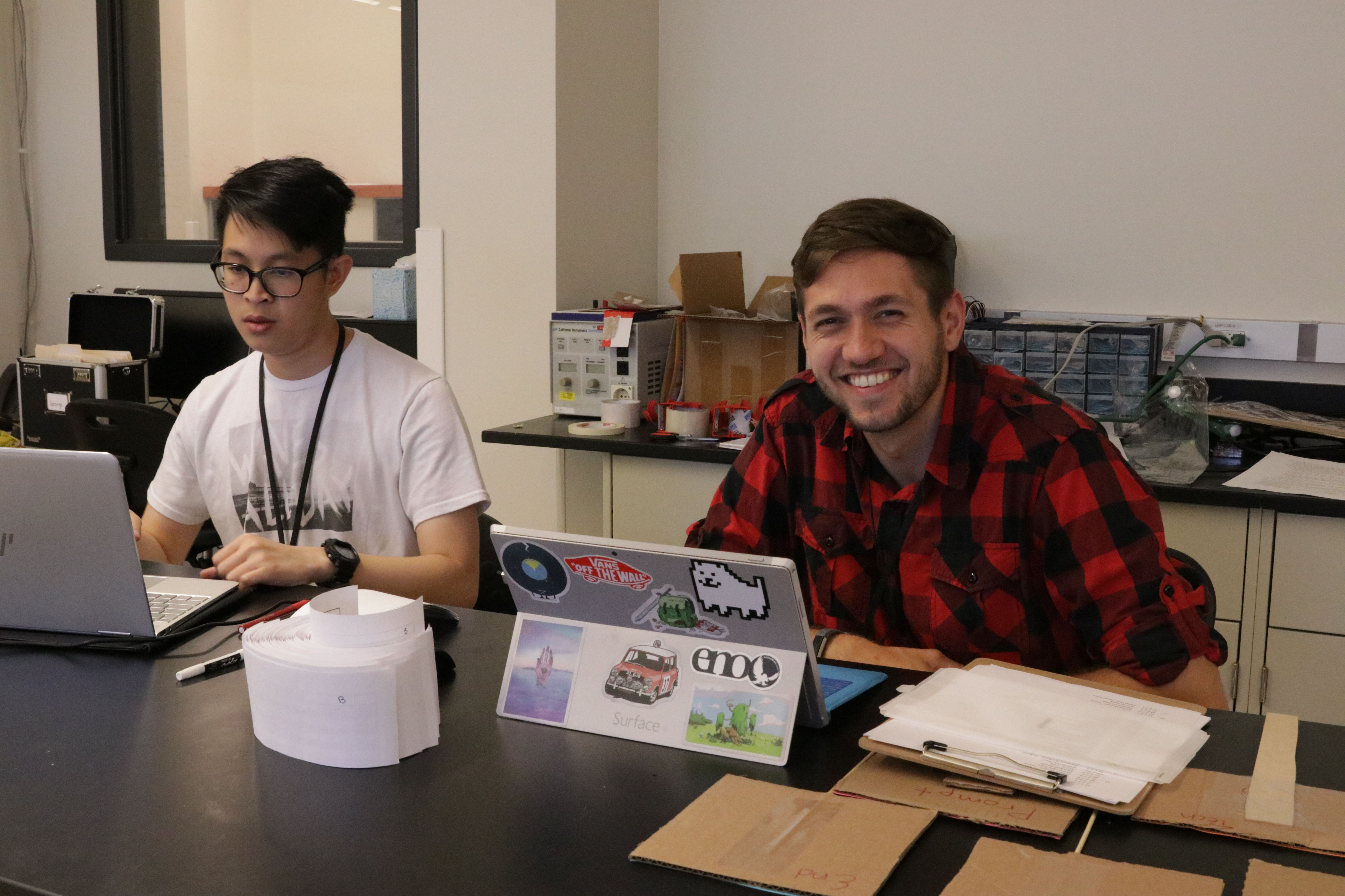 graduate students wok on their laptops