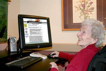 A senior works on a computer