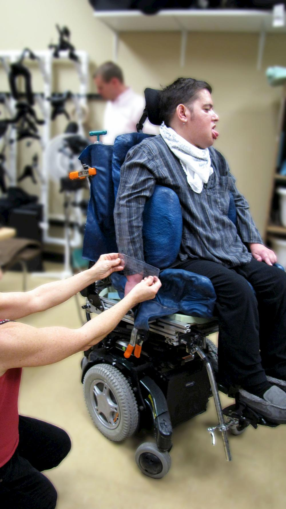 a therapist measure a person's wheelchair seating angle