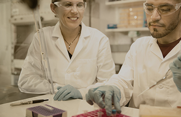 Teacher and student working in lab